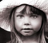 Black and white portrait of a girl in hat