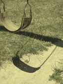 pic of swingset  - swingset with grass and shadow falling underneath - JPG