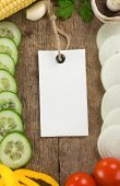 vegetable food and price tag over wood background texture