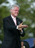 NEW YORK - JUNE 25:  Former U.S. President Bill Clinton gestures while on stage at the Greater New Y