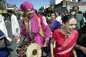 NEW YORK - AUGUST 30:  Hindus dance as they celebrate the birth of Ganesh, mythical god of new endea