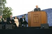 NEW YORK - JUNE 25: Rev. Billy Graham preaches at his crusade as Bill Clinton (2nd-L), his wife, Hil