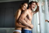Young Sensual Passionate Couple Making Love In Bed poster