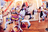 Colorful Old French Carousel In A Holiday Park. Merry-go-round With Horses - Merry-go-round Wooden H poster