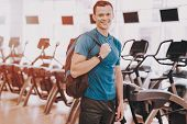 Smiling Young Man In Sport Club Near Treadmills. Healthy Lifestyle Concept. Sport And Training Conce poster