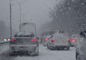 Look From The Car Of Heavy Snow Causes Traffic Trouble On The Frozen Winter Road poster