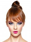 Closeup face of a beautiful woman with bright vivid  makeup. Fashion model with creative hairstyle e poster