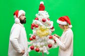 Family Couple Celebrate Christmas. New Year, Christmas Concept. Smiling Family Couple Decorated Chri poster