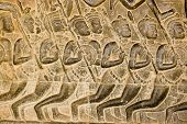 stock photo of mahabharata  - Bas relief carving of Kaurava foot soldiers heading at the Battle of Kurukshetra as described in the Mahabharata - JPG