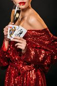 Cropped Image Of Girl In Red Shiny Dress Holding Joker And Queen Of Hearts Cards, Drinking Champagne poster