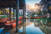 Wooden Boats Near The House In Braies Lake At Sunrise poster