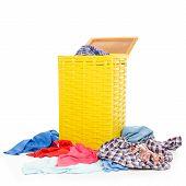 Yellow Laundry Basket With Clothing Pile Clothing On White Background Isolation poster