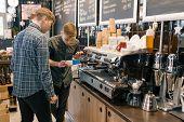 Coffee House, Small Business, Male Barista Near The Coffee Machine. Experienced Barista Coaching Tea poster