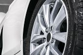 Cars In A Carwash. Car Wash With Foam In Car Wash Station. Carwash. Washing Car Wheel At The Station poster