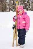 Girl With Skis In Hand.
