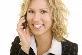Blonde corporate woman using her cell phone