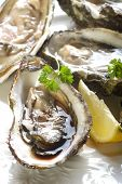 image of oyster shell  - opened oyster on dish - JPG