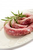 sausage with rosemary on dish