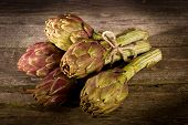 bunch of artichoke on wood background