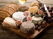 cheeseboard  with an assortment of cheeses bread and fruits