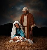 stock photo of manger  - Nativity scene with Mary Joseph and baby Jesus looking into hills in the distance - JPG
