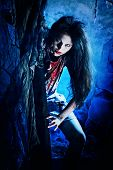 Bloodthirsty zombie standing at the night cemetery in the mist and moonlight. poster