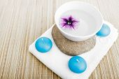 stock photo of unity candle  - spa concept build of stone white towel and blue candles - JPG