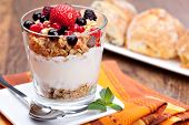 stock photo of yogurt  - yogurt with muesli and berries in small glass - JPG