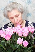 Portrait Of Granny Behind Bouquet Of Pink Rose