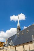 foto of assis  - famous historic hospice in Beaune France under blue sky