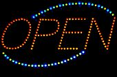 Glowing LED Open  sign on a black background
