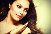 Beauty Girl portrait with long Hair. Beautiful Brunette Woman with Blowing Healthy Hair. Natural Beauty