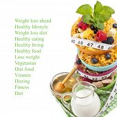 Diet weight loss breakfast concept with tape measure, tower stack isolated on a white background