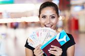stock photo of won  - happy young woman just won a trip abroad - JPG