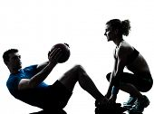 picture of studio  - one caucasian couple man woman personal trainer coach exercising weights fitness ball silhouette studio isolated on white background - JPG