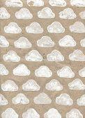 Kraft paper with black white speckles. Imprint stamp cloud.