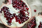 Half Of Delicious Red Pomegranate Photographed With Soft Focus