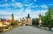 stock photo of bohemia  - Charles bridge with its statuette Lesser Town Bridge Tower and the tower of the Judith Bridge  - JPG