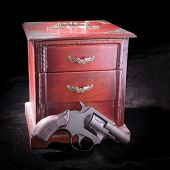 A Small Box And Revolver
