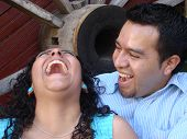 Hispanic Couple Laughing And Enjoying Eachother