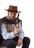 stock photo of gunslinger  - Bad gunslinger  in the old wild west on white background - JPG