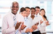 Successful business team applauding at the office