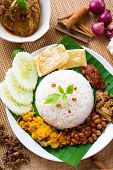 Nasi lemak kukus traditional malaysian spicy rice dish, fresh cooked with hot steam. Served with bel