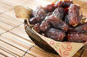 stock photo of dry fruit  - Dried date palm fruits or kurma - JPG