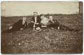 CZESTOCHOWA, POLAND, CIRCA 1934- vintage photo of four men picnicking with a bottle of vodka, Czesto