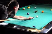 picture of snooker  - Man playing snooker in the dark club - JPG