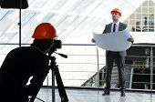 image of pro-life  - A photographer shoots architect in office building - JPG