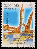 LAOS-CIRCA 1985: A stamp printed in the Laos, is pictured launching the spacecraft Apollo Program Apollo-Soyuz, circa 1985