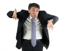stock photo of ignore  - Expressive businessman shrugging his shoulders in ignorance or indifference and gesturing with his hands isolated on white - JPG