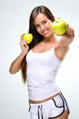 Eat healthily - Beautiful woman shows the apples